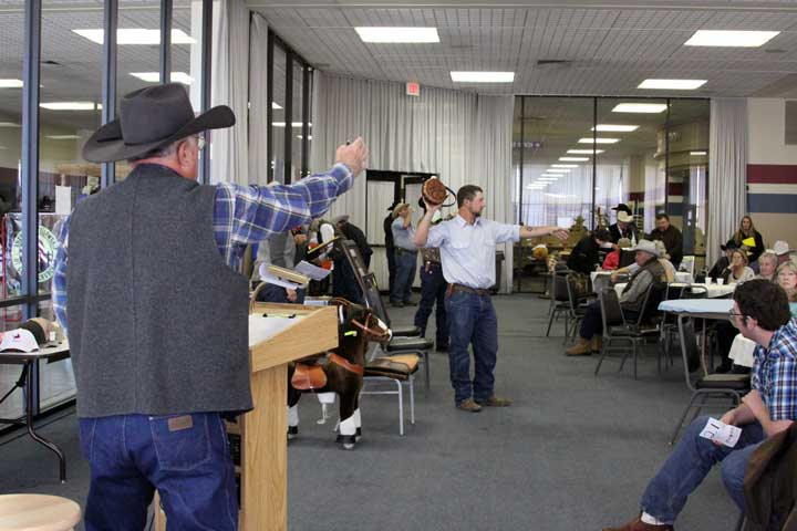 Auctioneer Gary Moore calls a bid during the WRCF Crisis Fund and Scholarship Brunch & Auction. The fundraiser featured donations from trade-show vendors and a variety of other generous supporters.