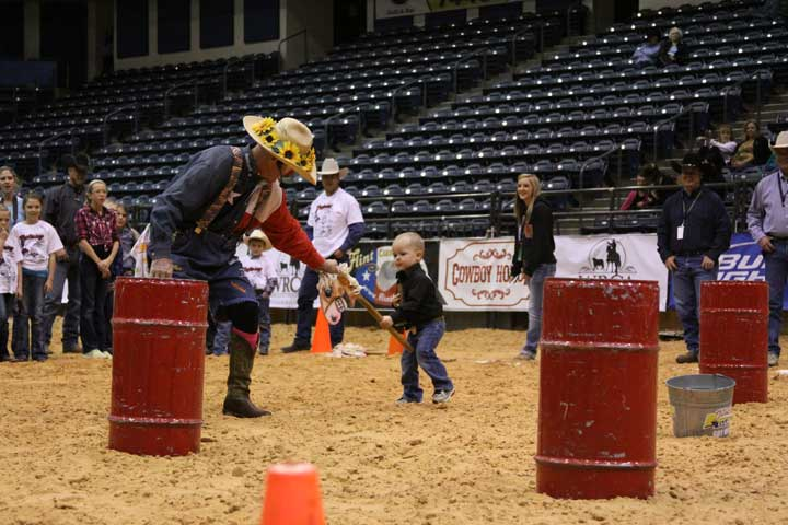 "We all need a little helping hand sometimes! Here, Pokey the Clown ""leads"" the horse for the littlest cowboy competing at the Junior Ranch Rodeo Finals."