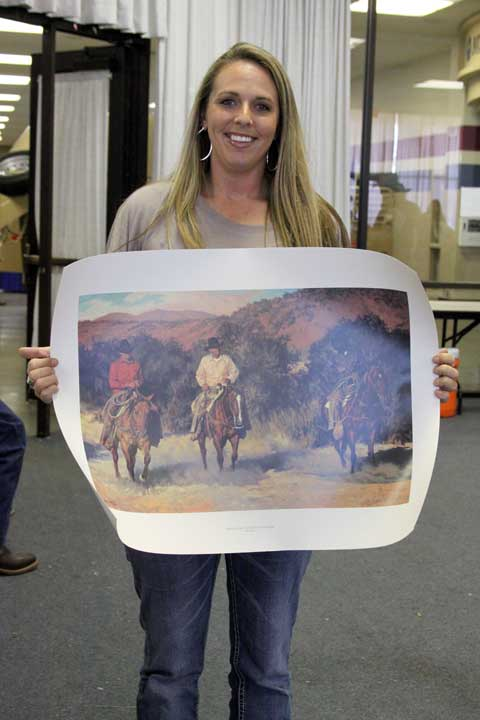 Shannon Adcock of Bartlesville, Oklahoma, took home one of the most sought-after items in the WRCF auction. It is a numbered artist