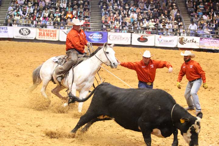 Doug Hall and Badger Jamey have a pretty good task on their hands, putting the initial stop on their wild cow. Their Broken H Ranch/Stierwalt Ranch team from Bronson, Kansas, and Shidler, Okla., stopped the clock at a very competitive :38.17.