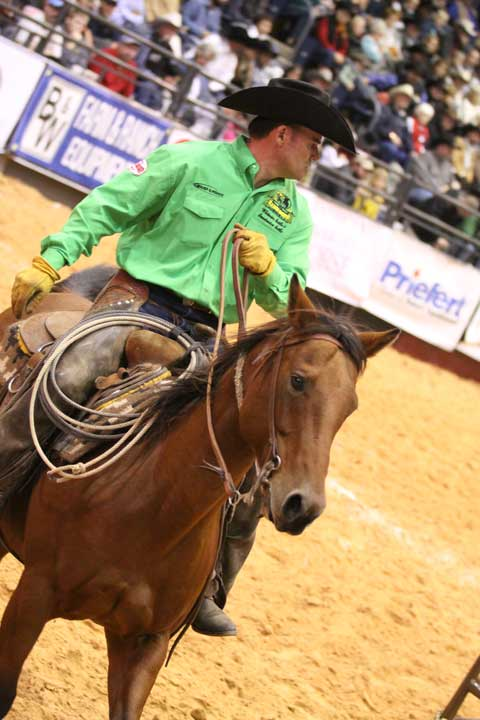 T.J. Mills of the Whitmire Land & Cattle and Sweetwater Cattle team rounds the pen in team penning, helping push the yearling cattle into the pen. They ended up placing second in the round.