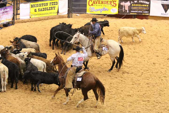 Matt Stockton and Hip Hop Dancer of Slash B Livestock/Dagger Draw Ranch ride into the team-branding event, alongside Cash Chamberlain and Ruby Red Amaretta of the Yoder Ranch/JOD Ranch team.