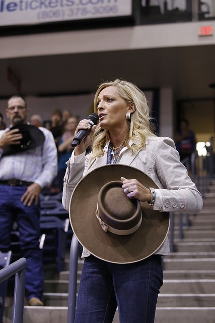 Trinity Seely, a Nebraska cattlewoman and recording artist, sang the national anthem to a  respectful, attentive crowd Thursday night.