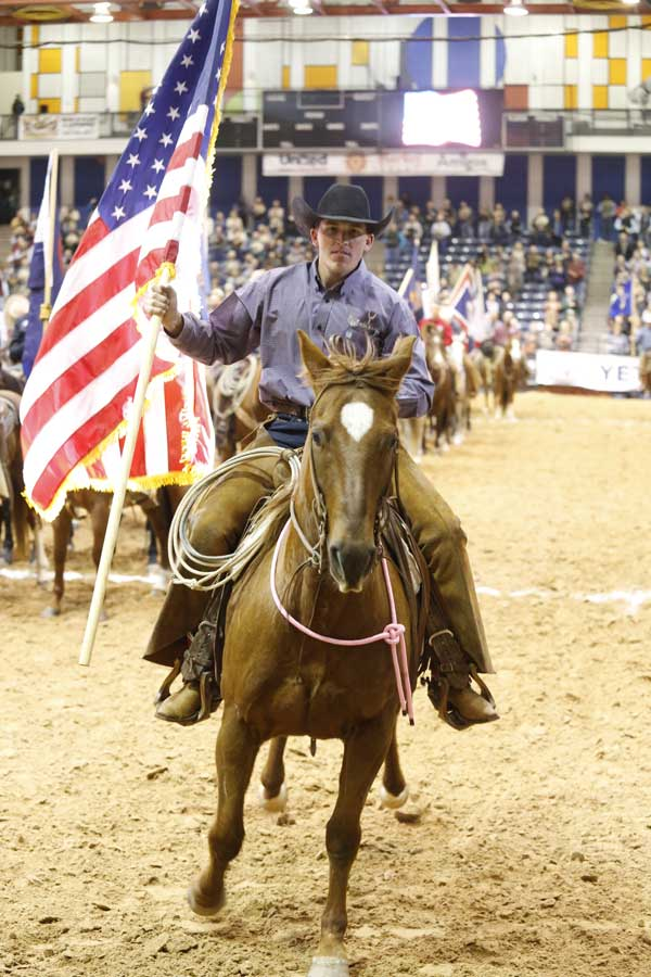 Last year's top hand, Jack Mitchell of the Crutch Ranch, presented the American flag to a standing ovation.