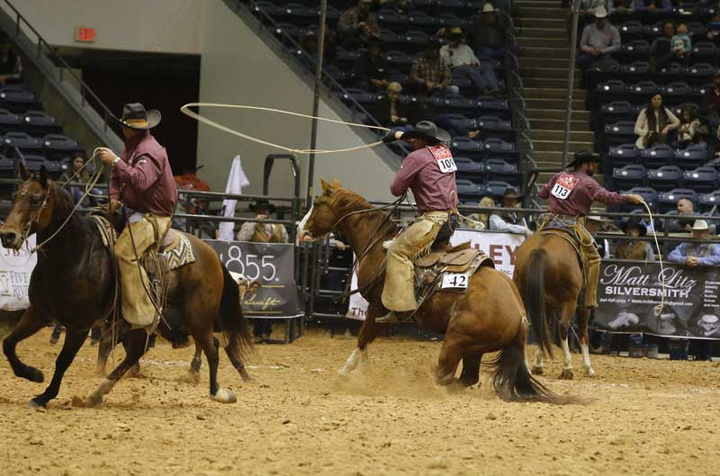 Buster Frierson of the Veale Ranch & Triangle Ranch team, center, displayed some tack of a different kind, riding Whistle Berries Box in a war bridle. The horse is sired by performance sire Snack Box and is owned by Buster.